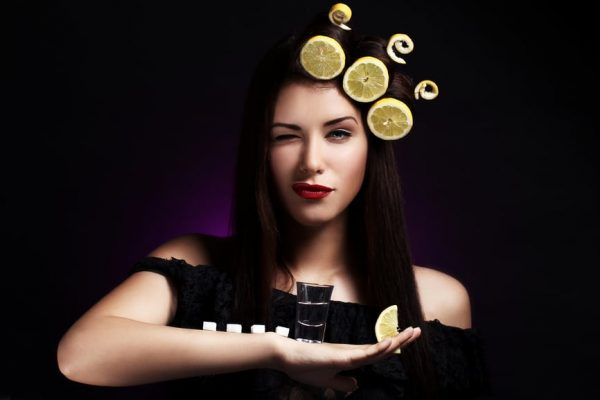 Sexy woman with lemons in her hairstyle